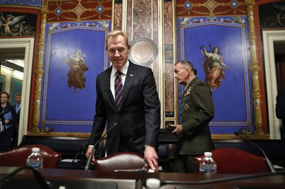 Acting Defense Secretary Patrick Shanahan, center, and Joint Chiefs Chairman Gen. Joseph Dunford arrive to testify at a Senate hearing on the defense budget on May 8, 2019, on Capitol Hill.
