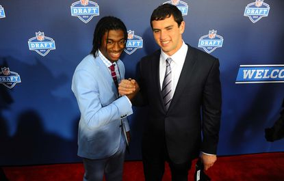 Former Stanford quarterback Andrew Luck (right) and Baylor quarterback Robert Griffin III (left) pose for a photo on the red carpet before the start of the 2012 NFL draft.