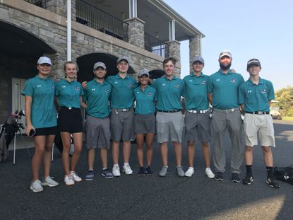 The Patterson Mill golf team members are, from left, Sydney Harrison, Ellie Wright, Sam Sapp, John Harrison, Paula Moon, Brendan Donnelly, Mitchell Walz, coach Ray Paquin and Brandon Palen.