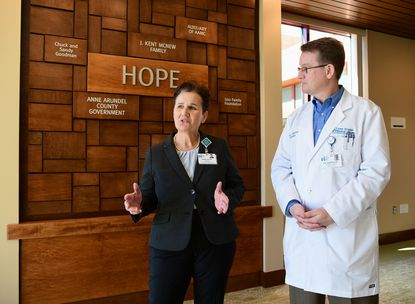 Anne Arundel Medical Center President Sherry Perkins, left, speaks about the center as Dr. Eric Anderson, Medical Director of Behavioral Health, listens. Tour of the new J. Kent McNew Family Medical Center, that will provide mental health services, in Annapolis.