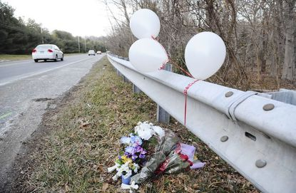 Flowers are left near the guardrail along Route 543 following the Feb. 20 crash that killed three people. They were among seven who died on Harford's highways in February.