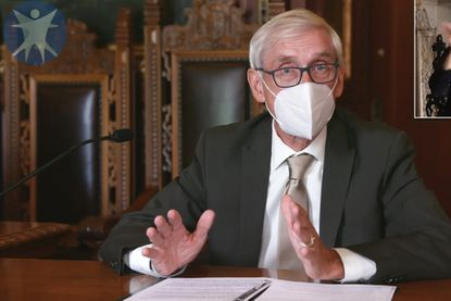 Wisconsin Gov. Tony Evers on Thursday, July 30, 2020, in Madison, Wis. Evers issued a statewide mask mandate amid a spike in coronavirus cases, which is now being challenged in court.