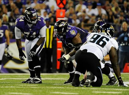 Michael Oher and Bobbie Williams line up at the line of scrimmage during the Ravens' preseason game against the Jacksonville Jaguars at M&T Bank Stadium in Baltimore Aug. 23. A former Cincinnati Bengal, Williams will face his ex-team on Monday in Baltimore's season opener, although it's unclear yet if he will start.