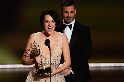 """British actress Phoebe Waller-Bridge accepts the Outstanding Lead Actress in a Comedy Series award for """"Fleabag"""" onstage during the 71st Emmy Awards at the Microsoft Theatre in Los Angeles on September 22, 2019."""