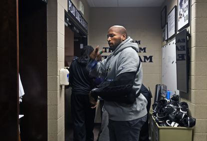 Owings Mills, MD--1/4/16-- The Ravens' Eugene Monroe leaves the locker room at the Under Armour Performance Center after the team finished a disappointing 5-11 season.