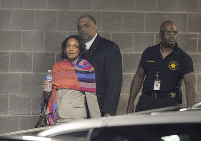 Mayor Sheila Dixon leaves court after a nine-woman, three-man jury was selected for her trial on theft charges.