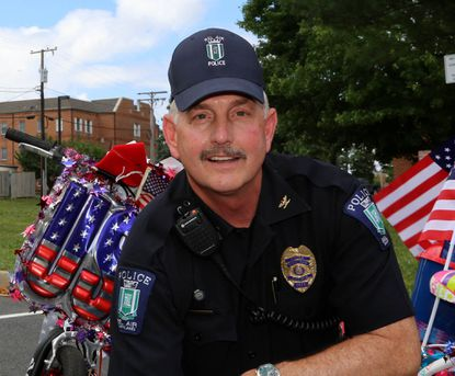 Bel Air Chief of Police Leo Matrangola, shown during the annual July 4 Bicycle Rodeo in 2013, has taken a medical leave of absence for two to three months, town officials said.