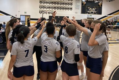The Marriotts Ridge volleyball team breaks down the huddle before its match against Mt. Hebron on Tuesday, Sept. 28.