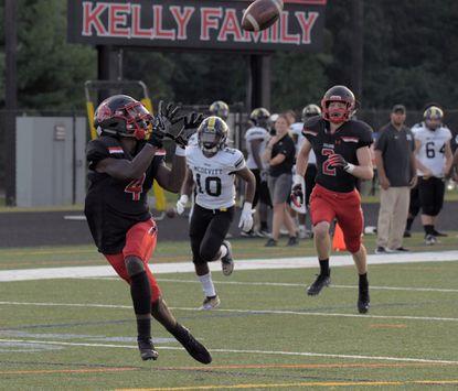 Archbishop Spalding's Molayo Irefin hauls in a 42-yard touchdown reception from quarterback Austin Tutas on Friday night as teammate Dustin Radford (2) and Bishop McDevitt defender Cordell Poplar (10) trail the play.