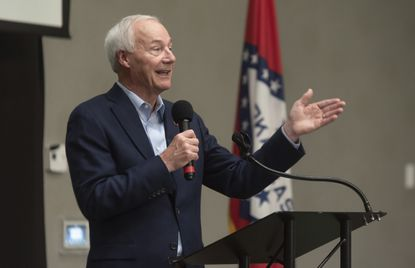 In this July 15, 2021, file photo, Arkansas Gov. Asa Hutchinson speaks during a town hall meeting in Texarkana, Ark. Facing growing vaccine hesitancy, governors in states hard hit by the coronavirus pandemic are asking federal regulators to grant full approval to the shots in the hope that will persuade more people to get them. (Kelsi Brinkmeyer/The Texarkana Gazette via AP, File)