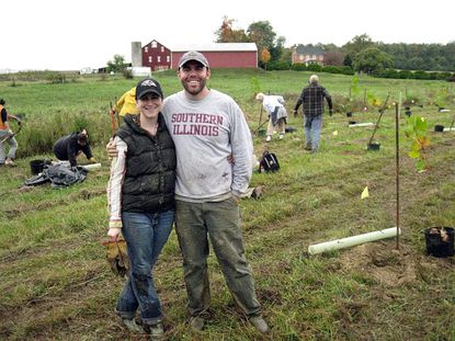 Gravel Springs Farm owners Emma and Paul Sorenson are pictured with volunteers during the last volunteer tree planting day at their farm in the fall.