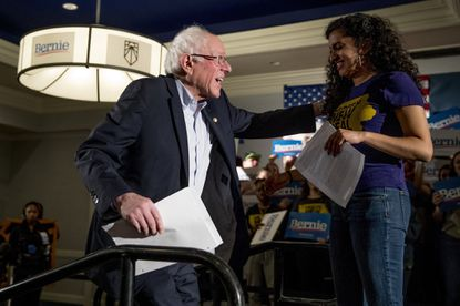 Democratic presidential candidate Sen. Bernie Sanders, I-Vt., left, is welcomed to the stage by Sunrise Movement co-founder Varshini Prakash at a climate rally with the Sunrise Movement at the Graduate Hotel on Jan. 12, 2020, in Iowa City, Iowa.