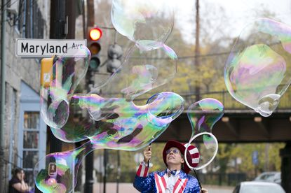 Barry Gibson, the Bubble Man and owner of The Forget-Me-Not Factory, has made bubbles in front of his store for years.