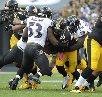 Ravens linebacker Jameel McClain makes a tackle in the first half against the Steelers.