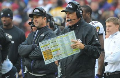 Former Ravens offensive coordinator Cam Cameron, right, stands next to coach John Harbaugh on Dec. 9, 2012, against the Redskins.