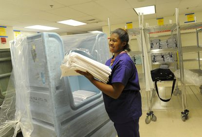 Kelsey Williams works in environmental services, where she helps with the laundry.