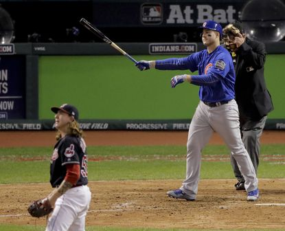 Chicago Cubs' Anthony Rizzo watches his two-run home rum off Cleveland Indians pitcher Mike Clevinger during the ninth inning of Game 6 of the Major League Baseball World Series Tuesday, Nov. 1, 2016, in Cleveland.