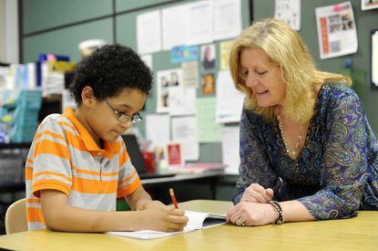Piney Ridge Elementary School teacher Sue Elseth works with 4th-grader Aren Hooper in Eldersburg Thursday, May 14, 2015. Elseth was among those who were recognized for their retirement from Carroll County public Schools in the 2018-19 school year.