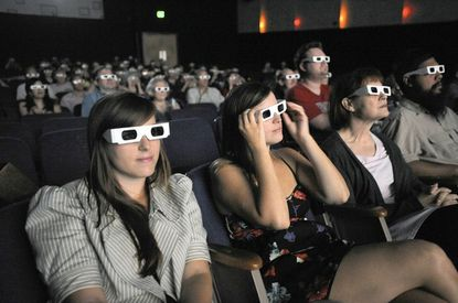 Wearing 3-D glasses, sisters Anna Hughes, Catherine Hughes (who are USC film students), sit with their mother Carmina Hughes as they watch Those Redheads From Seattle during the annual Maryland Film Festival at the Charles Theatre.