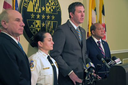 Baltimore County Councilman Julian Jones, far right, and County Executive Johnny Olszewski Jr. announced a revised police reform plan at a news conference Sept. 8. The two are shown at a January news conference with Councilman Izzy Patoka, left, and county Police Chief Melissa Hyatt.