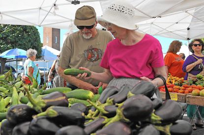 Bill and Judy Kendall, of Catonsville, shop for produce at one of last season's farm markets.