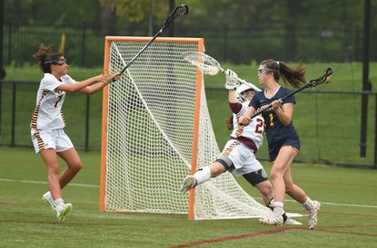 Catonsville's Sophi Wrisk, shown against Hereford in the Baltimore County championship last year, will play at the University of Maryland next year. She is one of three Catonsville midfielders, including Kolby Weedon and Lindsey Marshall, who will play Division I lacrosse.