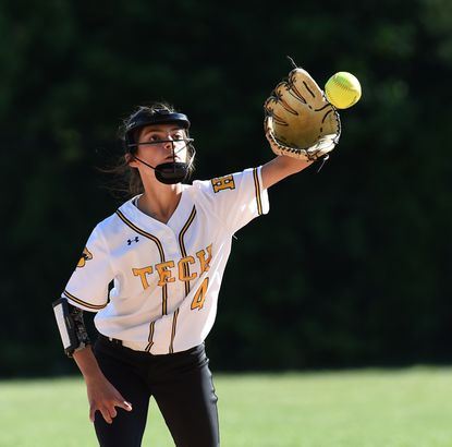 Harford Tech infielder Aubrey Gump reaches up to make the catch for an out during Wednesday's game at Aberdeen.