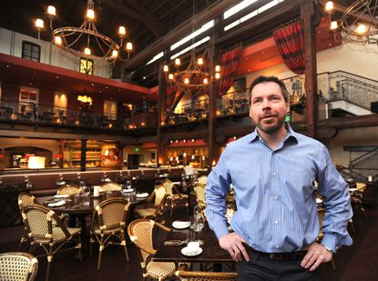 Tony Foreman, owner of the Foreman Wolf group of restaurants, which includes PAZO, shown, worries a change in overtime rules could disrupt how workers advance in the restaurant industry.