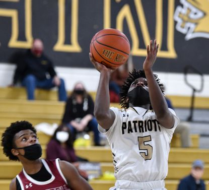 John Carroll's Jalen Bryant glides in for the score during the game against visiting Gerstell at John Carroll Friday, March 5, 2021.