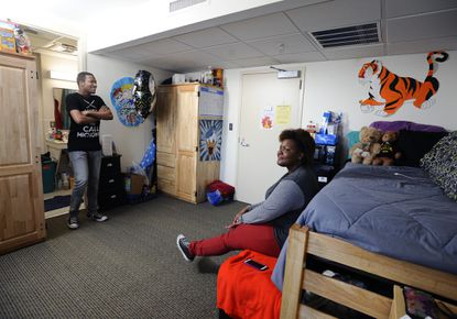 Sidney Garland, left, a junior at Towson University, shares a dorm room with friend Nita Strickland in a gender-neutral housing program. They especially like the semi-private bathroom, left, that only the two of them use.