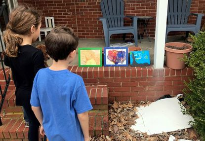 Ximena and Tiago Noroňa check out the impromptu art show displayed in the Springlake and Coachford neighborhood.