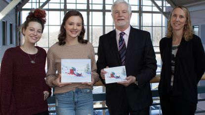Carroll Community College student Kristen Landsman, second from left, the winner of the annual contest to illustrate the school's holiday card, poses with Jessi Hardesty, left, the college's director visual arts, James D. Ball, president of the college; and Dana Champney, program director computer graphics.