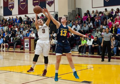 Catonsville's Taylor Barton, right, battles Paint Branch's Tyra Sinclair for a rebound in the Comets' 73-37 loss in the Class 4A North Region finals on Saturday night. Barton had a team-high 15 points.