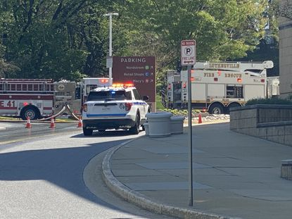 The Baltimore County Fire Department is investigating multiple vehicles on fire at Towson Town Center's parking garage, near Nordstrom. (Taylor Deville/The Baltimore Sun)