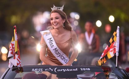Caitlyn Stupi, Miss Maryland 2019 and a Westminster resident, rides in the back of a convertible while participating in the Westminster Fallfest Parade on Sept. 26.