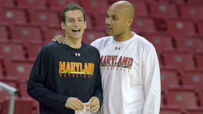 Former Terps assistant Dalonte Hill, right, talks with former graduate assistant Ryan Richman during practice Thursday, Oct. 20, 2011.