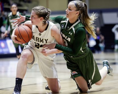 Army guard Jean Parker, left, and Loyola Maryland forward Steph Smith battle for a loose ball during the first half.