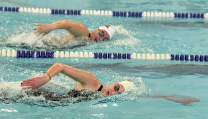 North Harford's Emily Iampieri, front, and Havre de Grace's Sydney James, back, stay close in the lead positions as they push through the late laps of the final heat in the girls 500 yard Freestyle event during a past North Region swim championship meet at Magnolia Middle School. Iamperi went on to win the race.