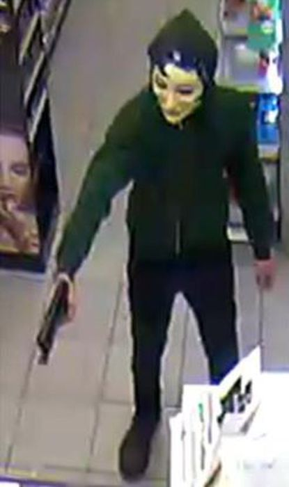 Police are seeking information leading to the arrest of two masked men who robbed the 7-Eleven on Edgewood Road at gunpoint Dec. 28.