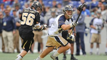 The Navy men's lacrosse team will miss long-stick midfielder Matt Rees (seen here taking control from Army West Point's Anthony George during a game in 2017 at Navy-Marine Corps Memorial Stadium), especially in the transition from defense to offense.