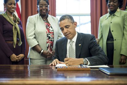 President Barack Obama signs a bill creating the Harriet Tubman Underground Railroad National Monument on the Eastern Shore.