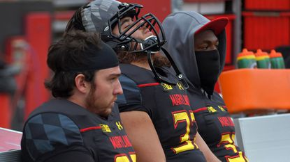 Players on the Maryland Terrapins bench can barely watch as the Michigan Wolverines extend their lead during the fourth quarter at Byrd Stadium. The Wolverines blanked the Terps, 28-0.