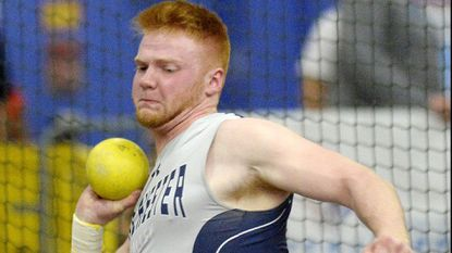 Manchester Valley's Evan Bare throws the shot put during the MPSSAA indoor track and field championships in Landover Tuesday, Feb. 20, 2018.