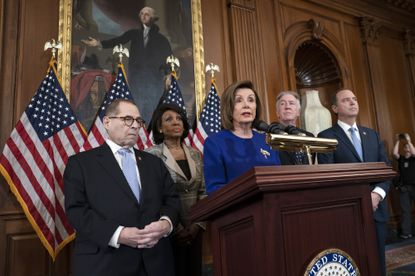 Speaker of the House Nancy Pelosi, joined by key House committee leaders, announces articles of impeachment against President Donald Trump at the Capitol on Dec. 10, 2019.