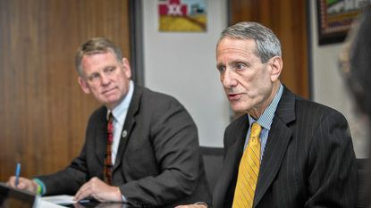 """Steve Sachs, right, chairman of the Spending Affordability Advisory Committee, says Howard County has """"matured"""" and has """"less potential growth."""" County Executive Allan Kittleman is next to Sachs."""