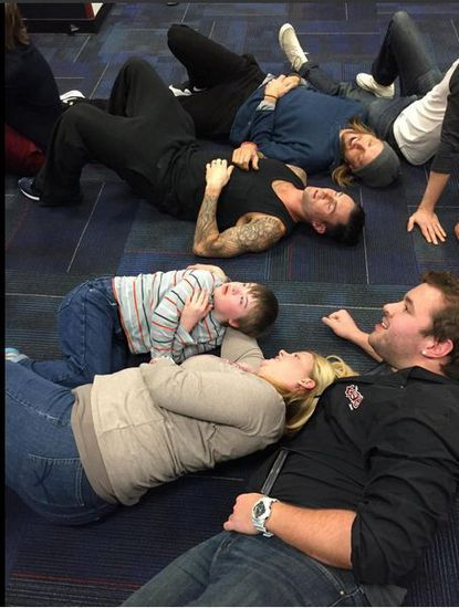 Adam Levine lies down on floor to comfort Howard County boy with Down syndrome