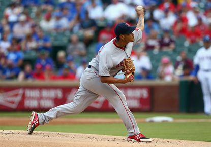 Eduardo Rodriguez of the Boston Red Sox throws against the Texas Rangers in the first inning at Globe Life Park in Arlington on May 28, 2015, in Arlington, Texas.