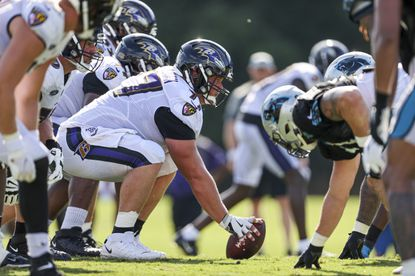 Ravens center Bradley Bozeman prepare to snap the ball during a joint practice with the Panthers in Spartanburg, S.C., on Thursday.