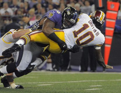 Ravens defensive tackle Brandon Williams hammers Washington Redskins quarterback Robert Griffin III.