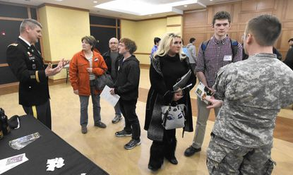 Military recruters talk to vistors to Congressman Chris Van Hollen's forum for students interested in attending US service academies at McDaniel College in Westminter on Thursday.